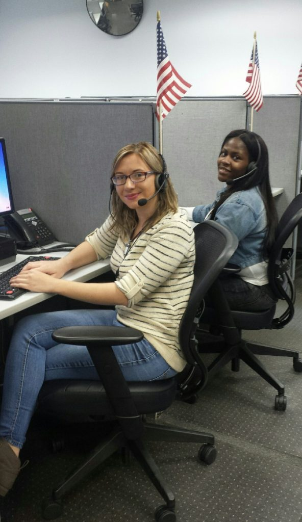 two coworkers happy and ready to take calls