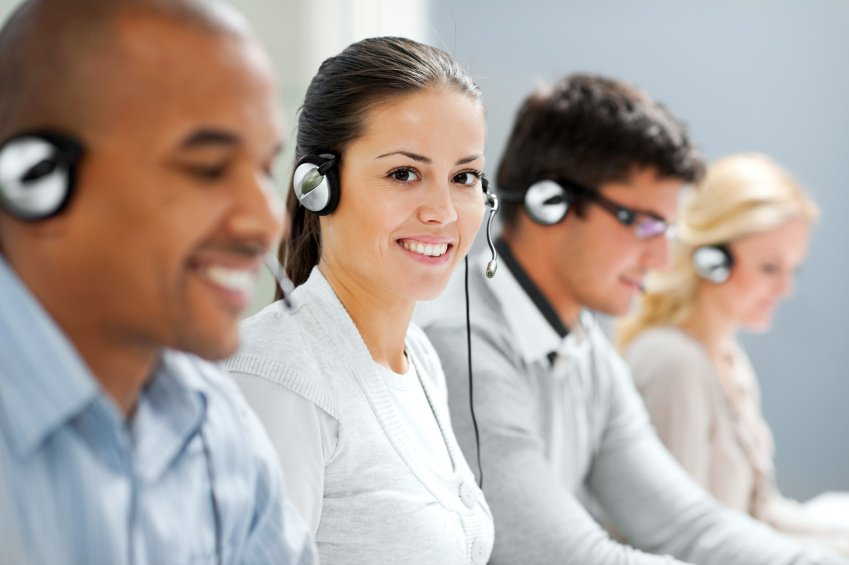 four coworkers happy to be on the job taking calls