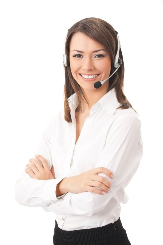women smiling into the camera wearing a headset