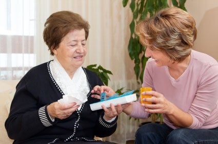 Two older women going over a solution