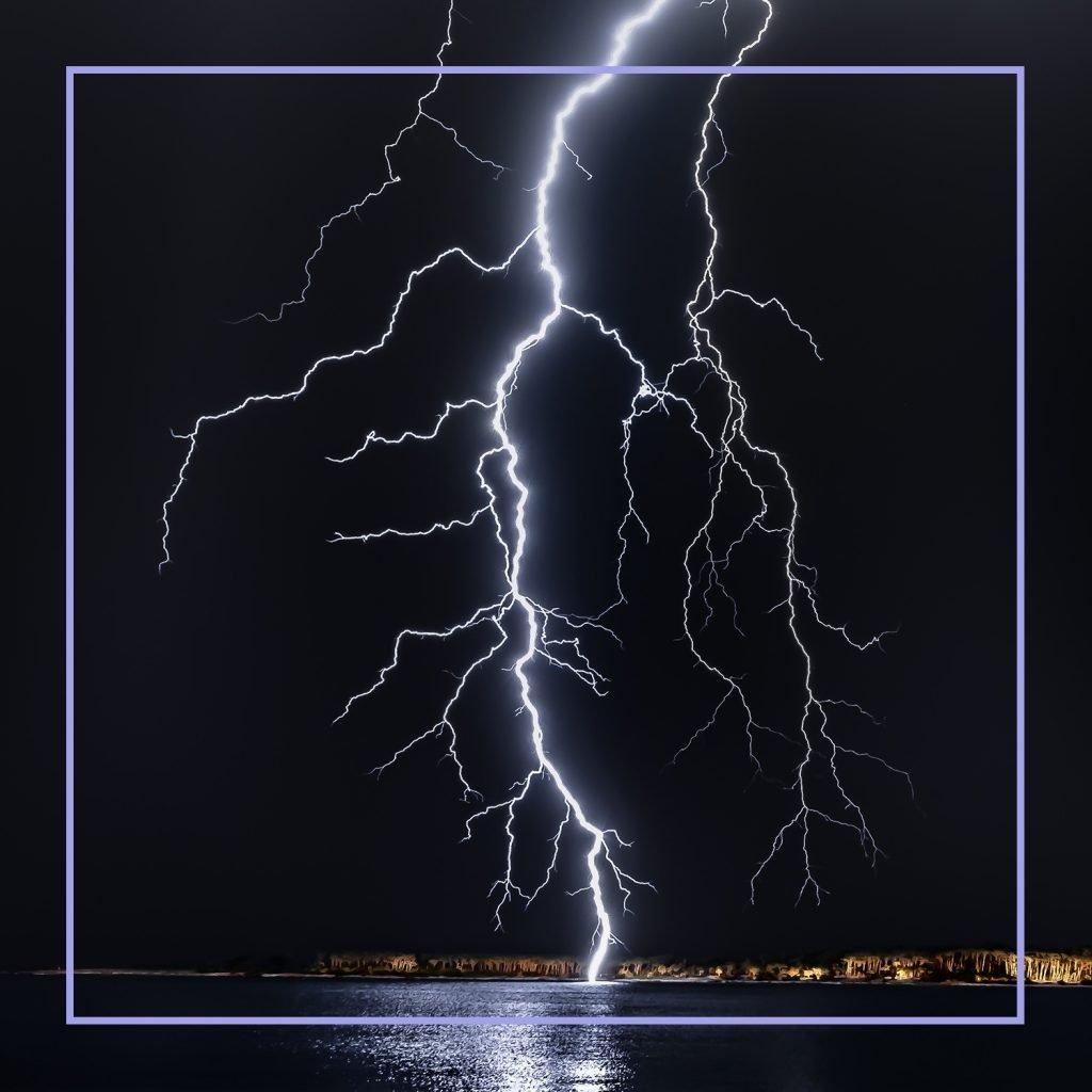 Large streak of lightening hitting a large river