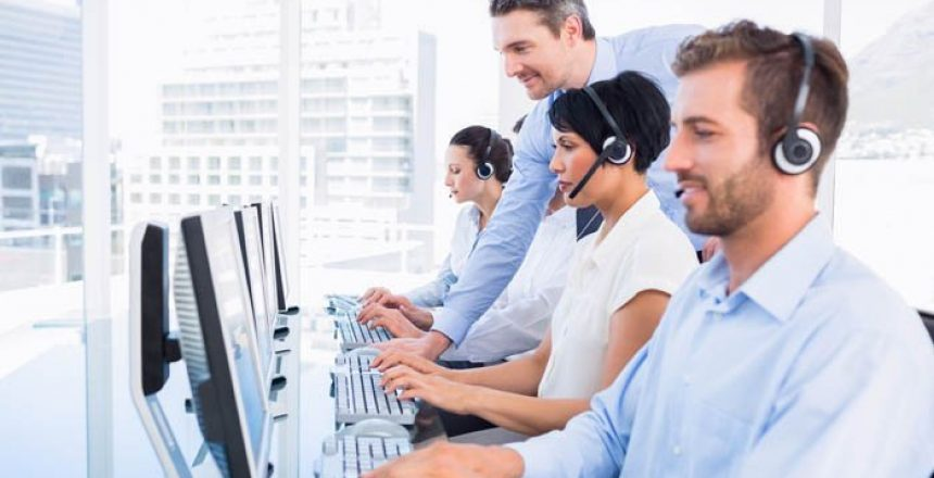 people sitting in a nice office taking calls