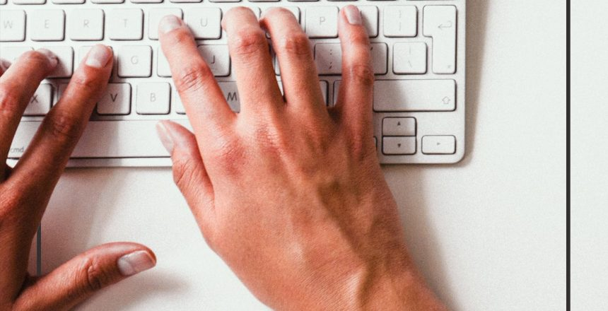 Person typing on a keyboard getting work done