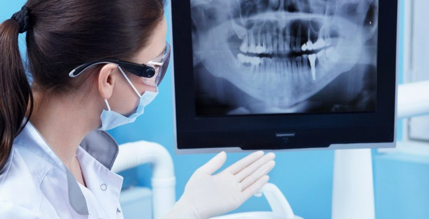dentist showing teeth xray to patient