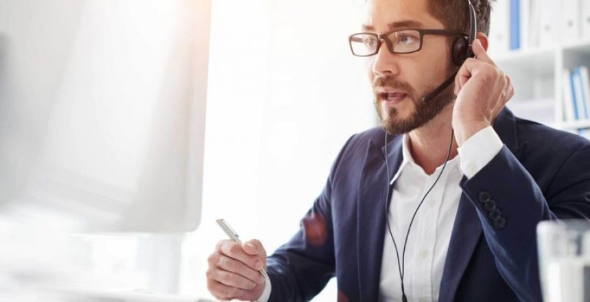 man listening closely to customer issues